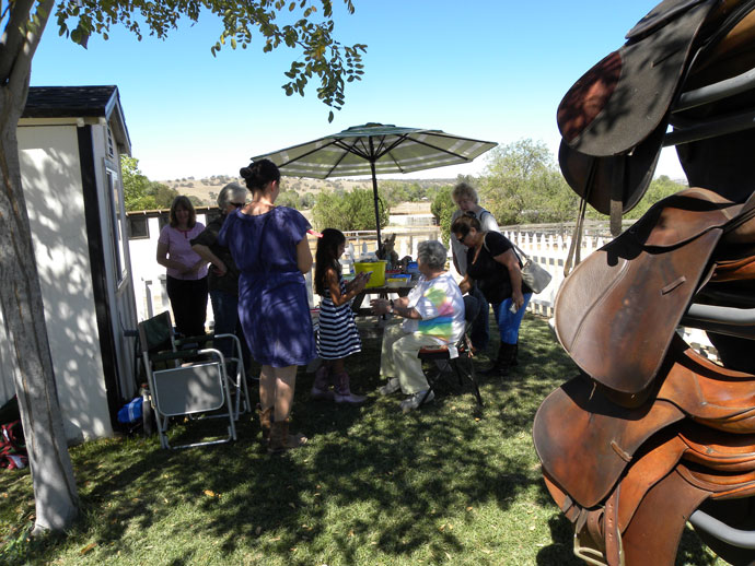 Guests fill out raffle tickets for horse related items.