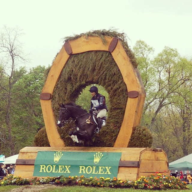 Gina and Ron going a through brush jump on Rolex Cross Country.
